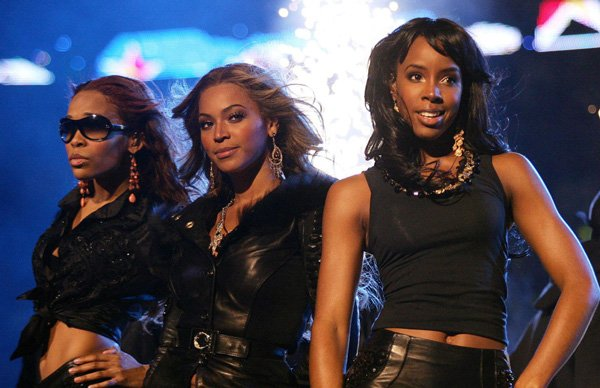 U.S. group Destiny's Child, from left to right, Michelle Williams, Beyonce Knowles and Kelly Rowland perform before the start of the NBA All-Star game on Feb. 20, 2005 in Denver. - Don Emmert/AFP